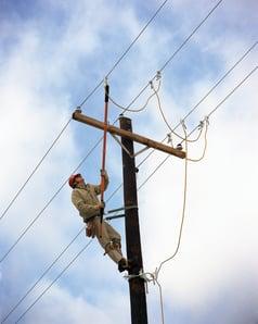 Line worker using cluster bar